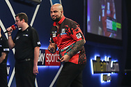 Devon Peterson wins his third round match against Steve West and celebrates during the World Darts Championships 2018 at Alexandra Palace, London, United Kingdom on 27 December 2018.