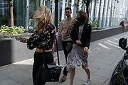 What few Londoners were in the City of London during the Coronavirus pandemic when most are still working from home,  found themselves being pushed along the street in strong winds as gusts reached the financial district during Storm Ellen, on 21st August 2020, in London, England.