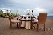 Romantic setting for a private dinner on the beach, with Pacific Ocean on your right, intimate resort on your left, protected by the Pedregal mountain on one side, and grasping the views to the end of Baja California Peninsula on the other side. From December to March you can also see the whales passing by!<br /> <br /> Romantic private dinner for two setting at Capella Pedregal Hotel & Resort.