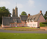 Attractive pink washed cottages at Cavendish, Suffolk, England