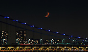 The moon over the eastern span of the George Washington Bridge. The George Washington bridge is the most heavily used suspension bridge in the world.