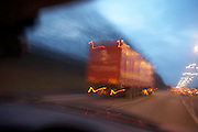 A Royal Mail lorry speeds up the darkening M1 motorway loaded with parcels and letters.