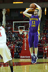 29 December 2011:  Johnny Moran fires a long shot over the arms of Tyler Brown during an NCAA mens basketball game between the Northern Illinois Panthers and the Illinois State Redbirds in Redbird Arena, Normal IL