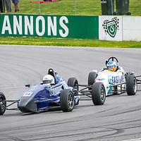 Glenn McNally (Spectrum 06) leads Daniel Ricciardo (Van Diemen RF90) through Turn 1 at Wanneroo Raceway during the 2005 WA State Championship meeting hosted by the WA Sporting Car Club.