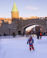 Quebec City, Quebec, Canada -- November 30, 2019.  Photo of a boy ice skating on an outdoor rink in Quebec City, Canada.