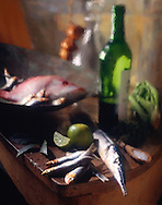 Red snapper, herrings with a bottle of wine in a kitchen with paint effect