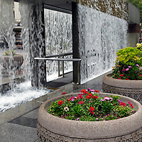 USA, Washington, Seattle. Refreshing Waterfall structure in Westlake Park;