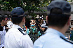 Hong Kong, China. 11th October 2019. Lunchtime flash mob demonstration by Pro-democracy demonstrators in Chater Square , Central District in Hong Kong. The protestors gathered to protest about treatment of those arrested by the police during Pro-democracy protests in the last 4 months. Police threatened to stop demonstration but it passed peacefully and concluded with march through city streets . Pic. Protestor shouts at police. Iain Masterton/Alamy Live News.