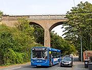 Park and Ride bus beneath railway viaduct built 1876, Spring Road, Ipswich, Suffolk, England, UK