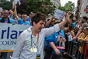 Yetta Kurland, a civil rights attorney and activist who is running for City Council in New York in 2013, waves to the crowd on Christopher Street.