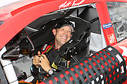 Matt Kenseth smiles after his pole-winning qualifying run for a NASCAR Sprint Cup race at Kansas Speedway, Friday, April 19, 2013 in Kansas City, Kansas. (AP Photo/Colin E. Braley)