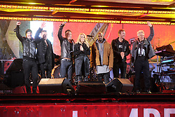 Dec. 1, 2014 - New York, New York, USA - The Edge, Larry Mullen Jr., Bruce Springsteen, Carrie Underwood, Chris Martin and Adam Clayton in a surprise concert by (RED) to mark World AIDS Day in Times Square on December 1, 2014 in New York City (Credit Image: © Future-Image/ZUMA Wire)