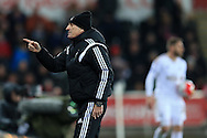 Swansea city head coach Francesco Guidolin  makes a point to his coaching staff.Barclays Premier league match, Swansea city v Aston Villa at the Liberty Stadium in Swansea, South Wales on Saturday 19th March 2016.<br /> pic by  Andrew Orchard, Andrew Orchard sports photography.