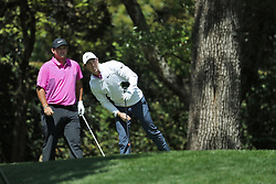 April 8, 2018 - Augusta, GA, USA - Patrick Reed, left, prepares to hit as Rory Mcllroy watches his drive on two during the final round of the Masters at Augusta National Golf Club on Sunday, April 8, 2018, in Augusta, Ga. (Credit Image: © Curtis Compton/TNS via ZUMA Wire)