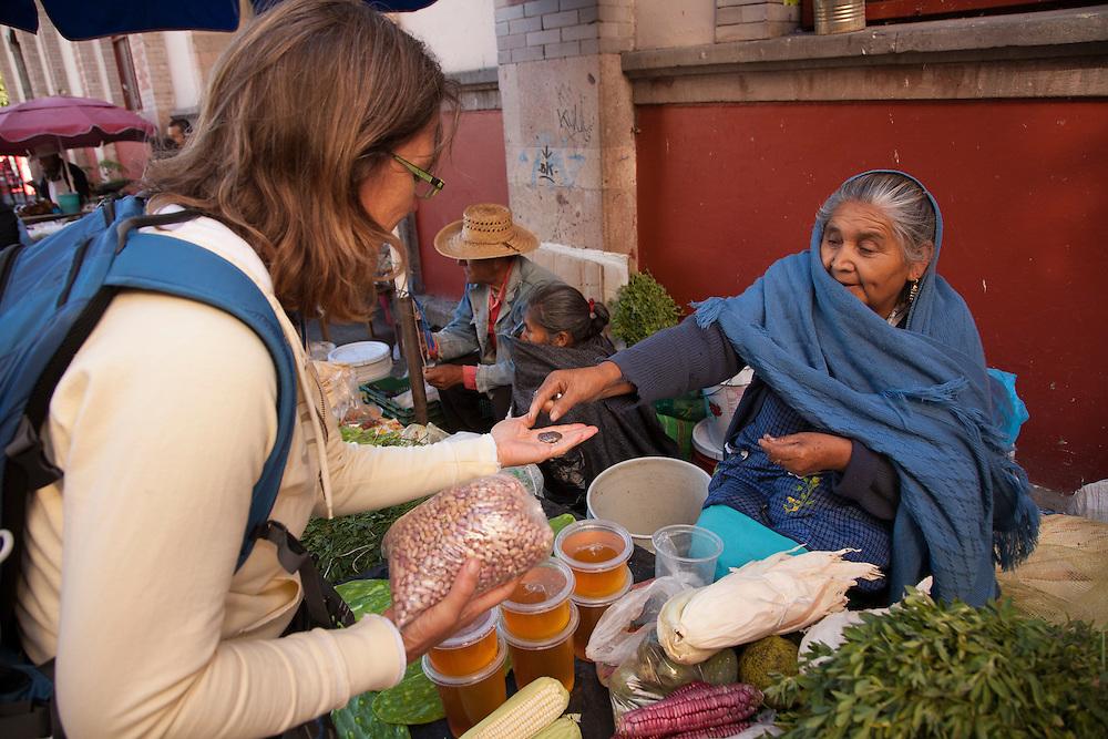 North America, Mexico, Guanajuato State, Guanajuato,  woman buying beans in market.  The historic city of Guanajuato is a UNESCO World Heritage Site.  MR