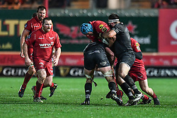 Scarlets' Tadhg Beirne is tackled by Ospreys' Dan Lydiate and Scott Baldwin - Mandatory by-line: Craig Thomas/Replay images - 26/12/2017 - RUGBY - Parc y Scarlets - Llanelli, Wales - Scarlets v Ospreys - Guinness Pro 14