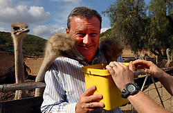 OUDTSHOORN, SOUTH AFRICA - MAY-1-2004 -.Marc Verwilghen, Belgian Minister of Development and Cooperation, visits the Ostrich Leather World store and Ostrich Farm in Oudtshoorn, South Africa . The enterprise is owned by Philippe Capelle formerly of Ardooie, Belgium in West Flanders. (PHOTO © JOCK FISTICK)