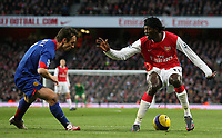 Photo: Paul Thomas.<br /> Arsenal v Manchester United. The Barclays Premiership. 21/01/2007.<br /> <br /> Emmanual Adebayor (R) of Arsenal tries to get past Gary Neville.