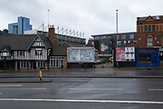 Empty advertising billboard in Birmingham city centre which is virtually deserted under Coronavirus lockdown on a wet rainy afternoon on 28th April 2020 in Birmingham, England, United Kingdom. Britains second city has been in a state of redevelopment for some years now, but with many outdated architectural remnants still remaining, on a grey day, the urban landscape appears as if frozen in time. Coronavirus or Covid-19 is a new respiratory illness that has not previously been seen in humans. While much or Europe has been placed into lockdown, the UK government has put in place more stringent rules as part of their long term strategy, and in particular social distancing.