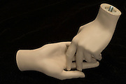 two mannequin hands touching