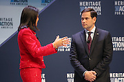 Senator and GOP presidential candidate Marco Rubio listens to a question from SC Gov. Nikki Haley at the Heritage Foundation Take Back America candidate forum September 18, 2015 in Greenville, South Carolina. The event features 11 presidential candidates but Trump unexpectedly cancelled at the last minute.