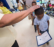 Houston ISD staff, parents and students attend a Home Instruction for Parents of Pre-K Youth (HIPPY) meeting at DeBakey High School, June 25, 2014.