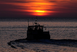 © Licensed to London News Pictures. <br /> 05/05/2016. <br /> Staithes, UK.  <br /> <br /> The crew of the Mainstay leave the harbour to check lobster and crab pots as the sun rises in the small North Yorkshire fishing village of Staithes.<br />   <br /> Photo credit: Ian Forsyth/LNP