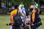 A team of Legal Observers are seen wearing protective masks against the spread of coronavirus, take part in a protest organised by Black Lives Matter, in Hyde Park, London, Saturday, June 20, 2020, in the wake of the killing of George Floyd by police officers in Minneapolis, USA last month that has led to anti-racism protests in many countries calling for an end to racial injustice. Anti-racism demonstrators are holding a fourth weekend of protests across the U.K., despite a ban on large gatherings because of the coronavirus pandemic. Demonstrations are taking place Saturday in cities including London, Manchester, Edinburgh and Glasgow. (Photo/ Vudi Xhymshiti)