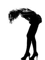 stylish silhouette caucasian beautiful woman sexy  attitude adusting mini skirt behavior clothes full length on studio isolated white background