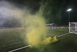 20 February 2017 - The FA Cup - (5th Round) - Sutton United v Arsenal - Sutton fans throw a yellow flare onto the pitch - Photo: Marc Atkins / Offside.