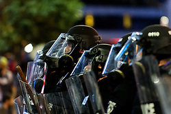 September 21, 2016 - Charlotte, North Carolina, United States of America - Sept. 21, 2016 - Charlotte, UNITED North CarolinaS - , Police officers line up along Trade Street during a protest and eventual riot in Uptown Charlotte, North Carolina, The United States, Wednesday 21 September 2016. This is the second day of violence that erupted after a police officer's fatal shooting of an African-American man Tuesday afternoon. (Credit Image: © Sean Meyers via ZUMA Wire)