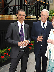 Left to right, ANDRE PORTASIO and PAUL O'GRADY at a reception for the Friends of The Castle of Mey held at The Goring Hotel, London on 20th May 2008.<br /> <br /> NON EXCLUSIVE - WORLD RIGHTS