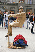 Street performer at Dam square, Amsterdam, Netherlands