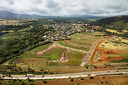 Cul-de-sac roads for a large new subdivision are layed out in Lihue, seen from a helicopter tour over Kauai, Hawaii, USA.