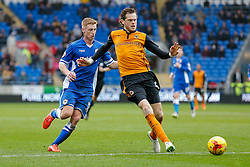 Richard Stearman of Wolverhampton Wanderers is challenged by Eoin Doyle of Cardiff City - Photo mandatory by-line: Rogan Thomson/JMP - 07966 386802 - 28/02/2015 - SPORT - FOOTBALL - Cardiff, Wales - Cardiff City Stadium - Cardiff City v Wolverhampton Wanderers - Sky Bet Championship.