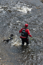 © Licensed to London News Pictures. 27/07/2017. Builth Wells, Powys, Wales, UK. Mountain Rescue Teams search in the River Wye for missing nineteen-year-old teenager James Corfield who was last seen at the nearby White Horse Pub on Monday the 24th July 2017. Photo credit: Graham M. Lawrence/LNP