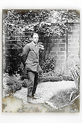 young adult businessman standing in backyard early 1900s Paris