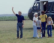 President Jimmy Carter disembarks Marine One - arriving in Plains, GA. With the President is his mother, Lillian Carter, a young friend of Amy's (back toward camera), daughter Amy, accompanied by her nanny, Mary Prince. Ms. Prince, a black woman, -once convicted of murder in Georgia - was assigned to work as a trustee at the Georgia governor's mansion in a work-release program. Governor Carter became acquainted with Ms. Prince and was firmly convinced that she was innocent of the murder charge. Carter later applied to be Ms. Princes' parole officer so that she could come to the White House to become Amy's nanny. Later, Prince was pardoned .