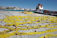 Greece, Koufonissi, Cyclades: Nets to dry in the port of Koufonissi