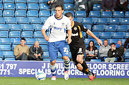 Bury's Marco Navas ( brother of Man city player Jesus Navas) breaks away from Newport County's Andrew Hughes. Skybet Football League two match, Bury v Newport county at Gigg Lane in Bury on Saturday 5th Oct 2013. pic by David Richards, Andrew Orchard sports photography,