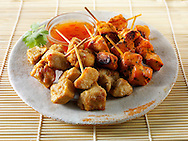 Traditional oriental satay with chilli dipping sauce