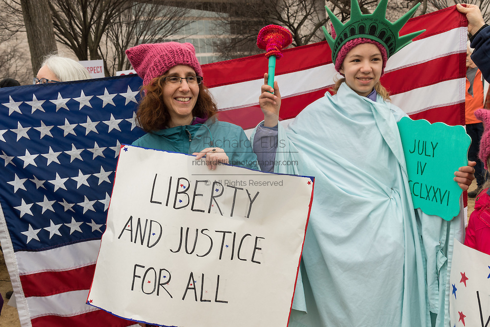 Demonstrators rally during the Women's March on Washington in protest to President Donald Trump January 21, 2017 in Washington, DC. More than 500,000 people crammed the National Mall in a peaceful and festival rally in a rebuke of the new president.
