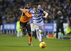 Readings Jon Daoi Boovarsson is tackled from behind by Wolves Bright Enobakhare during the Sky Bet Championship match at the Madejski Stadium, Reading.