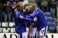 Photo: Pete Lorence.<br />Leicester City v Plymouth Argyle. Coca Cola Championship. 11/11/2006.<br />Iain Hume and Richard Stearman congratulate Levi Porter for his equalising goal.