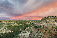 Clearing storm at sunrise over badlands, Theodore Rossevelt National Park, North Dakota