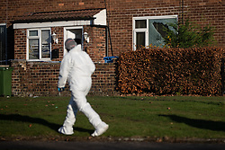 FILE PICTURE © Licensed to London News Pictures . 18/11/2018. Manchester , UK . Forensic scenes of crime investigators work behind a sealed off cordon at a house on 23 Hattersley Road West , a block away from the Harehill Tavern , in a residential area of Hyde , after a man was shot the stomach last night (17th November 2018) . Photo credit : Joel Goodman/LNP