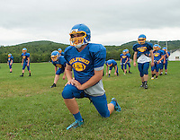 Gilford quarterback Jack Athanas leads his team mates during warmup on Tuesday afternoon's practice at the Meadows Field.  (Karen Bobotas/for the Laconia Daily Sun)
