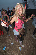 Fans enjoy Dizzee Rascal on the Pyramid Stage. The 2013 Glastonbury Festival, Worthy Farm, Glastonbury. 28 June 2013.
