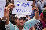 24 MAY 2014 - BANGKOK, THAILAND:  Thai anti-coup / pro-democracy protestors gather at Victory Monument in Bangkok. There were several marches in different parts of Bangkok to protest the coup that unseated the popularly elected government. Soldiers and police confronted protestors and made several arrests but most of the protests were peaceful. The military junta also announced that firing of several police commanders and dissolution of the Thai Senate. The junta also changed its name from National Peace and Order Maintaining Council (NPOMC) to the National Council for Peace and Order (NCPO).   PHOTO BY JACK KURTZ