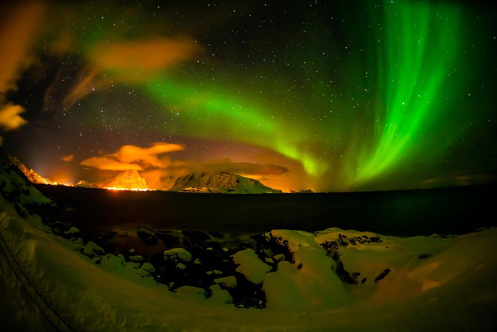Northern Lights (Aurora Borealis) seen from along the E10 near Reine, Moskenoesoya Island, Lofoten Islands, Arctic, Northern Norway.